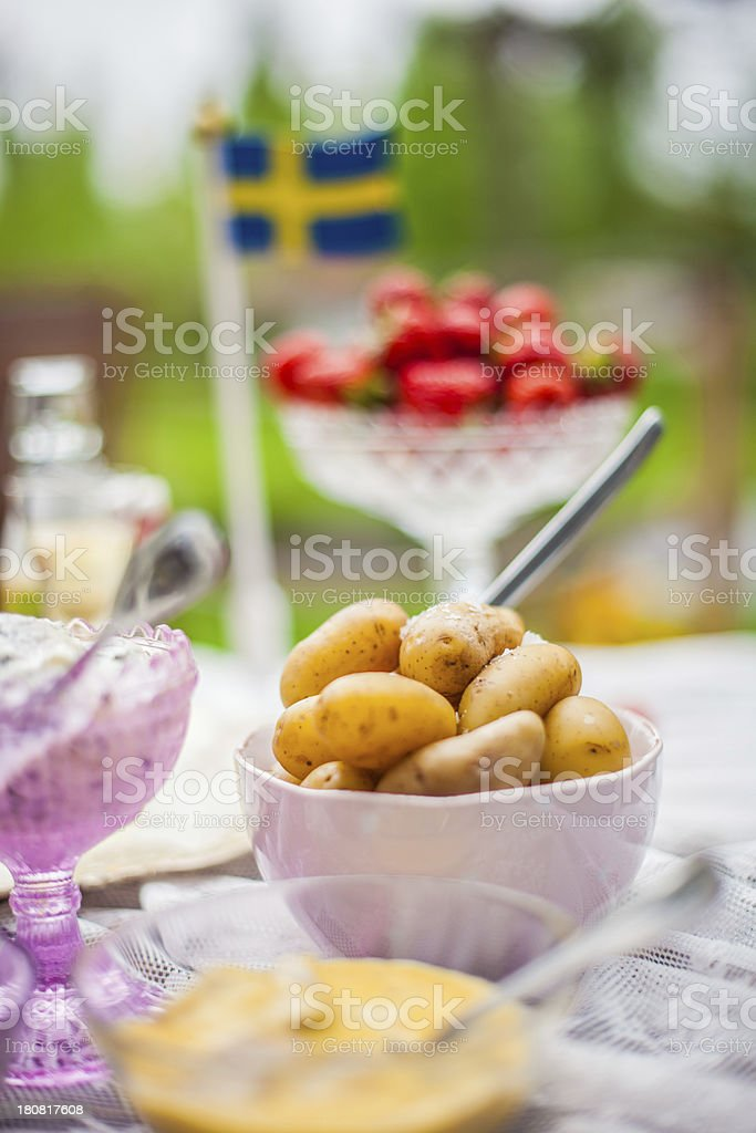 Smörgåsbord with pickled herring and snaps royalty-free stock photo