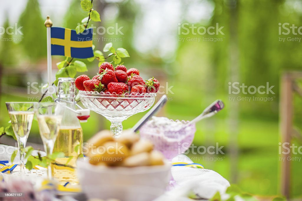 Smörgåsbord with pickled herring and snaps stock photo