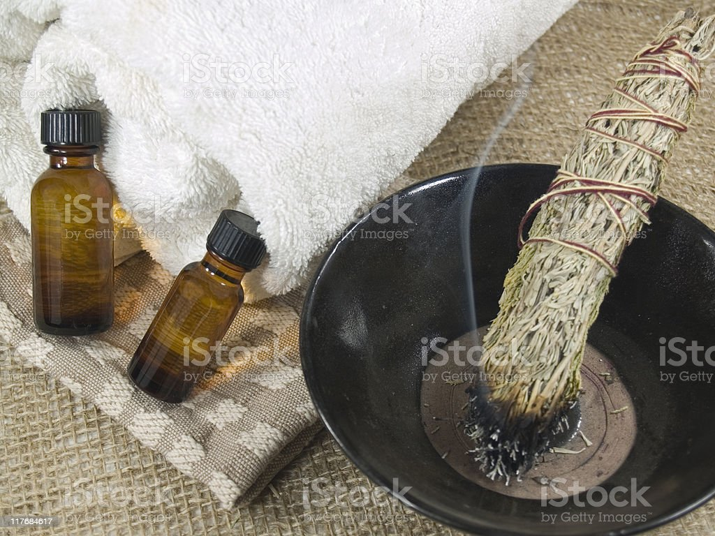 Smudge stick and massage oil stock photo