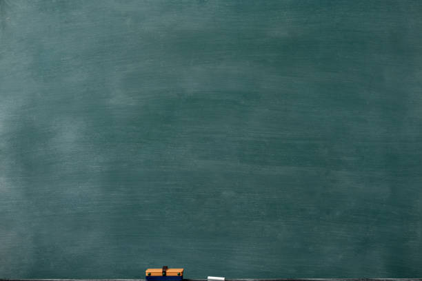 Smudged blank blackboard with board eraser and chalk stock photo