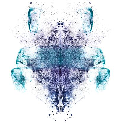 Smudged blue and purple eyeshadows in Rorschach inkblot patterns on a white background.