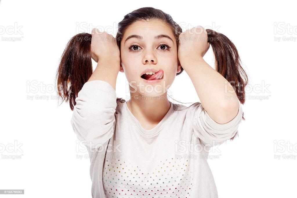 Smug Teenage Girl Pokes Out Her Tongue Stock Photo - Download Image