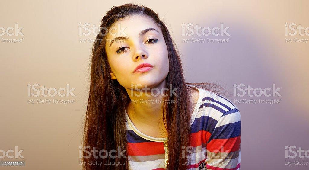Smug young girl stock photo