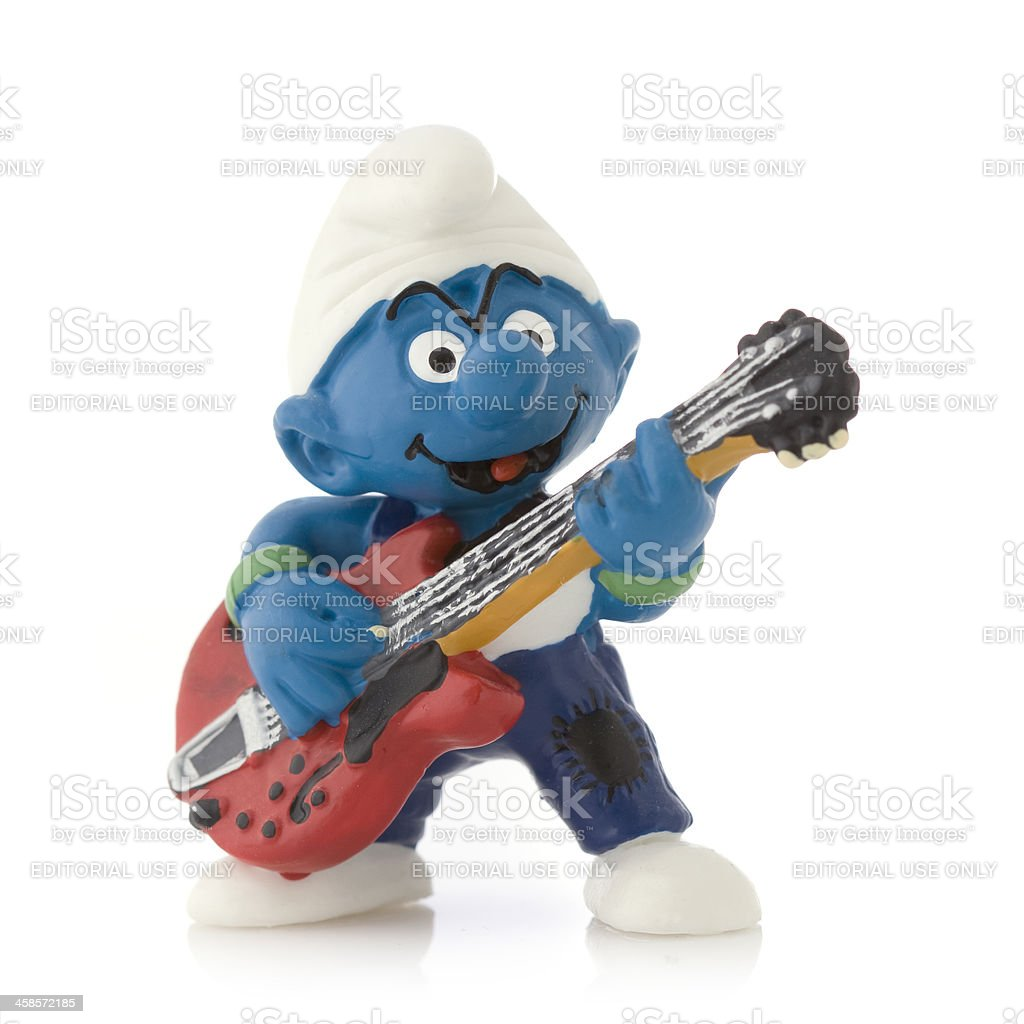 Smurf with electric guitar royalty-free stock photo