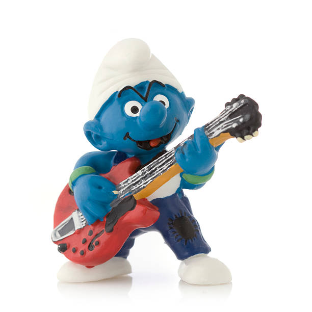 Smurf with electric guitar stock photo