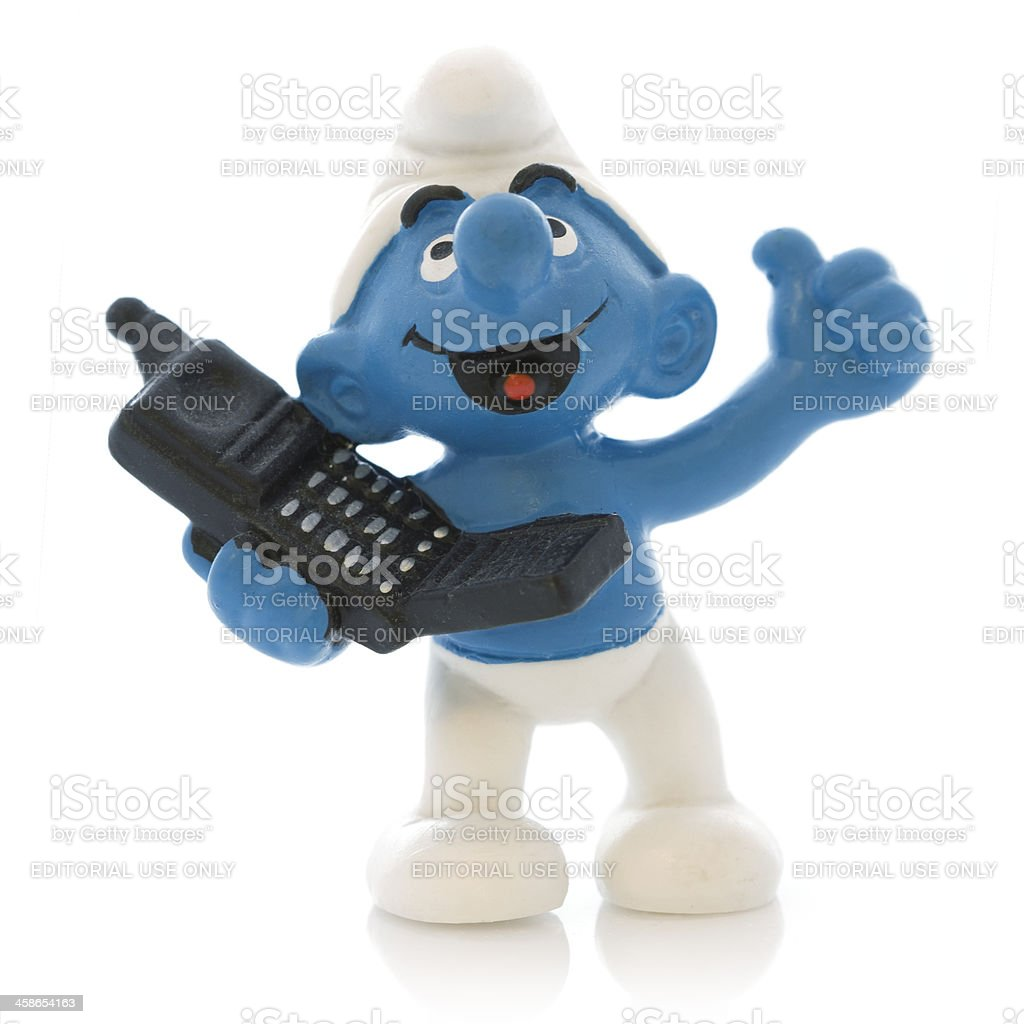 Smurf with mobile phone stock photo