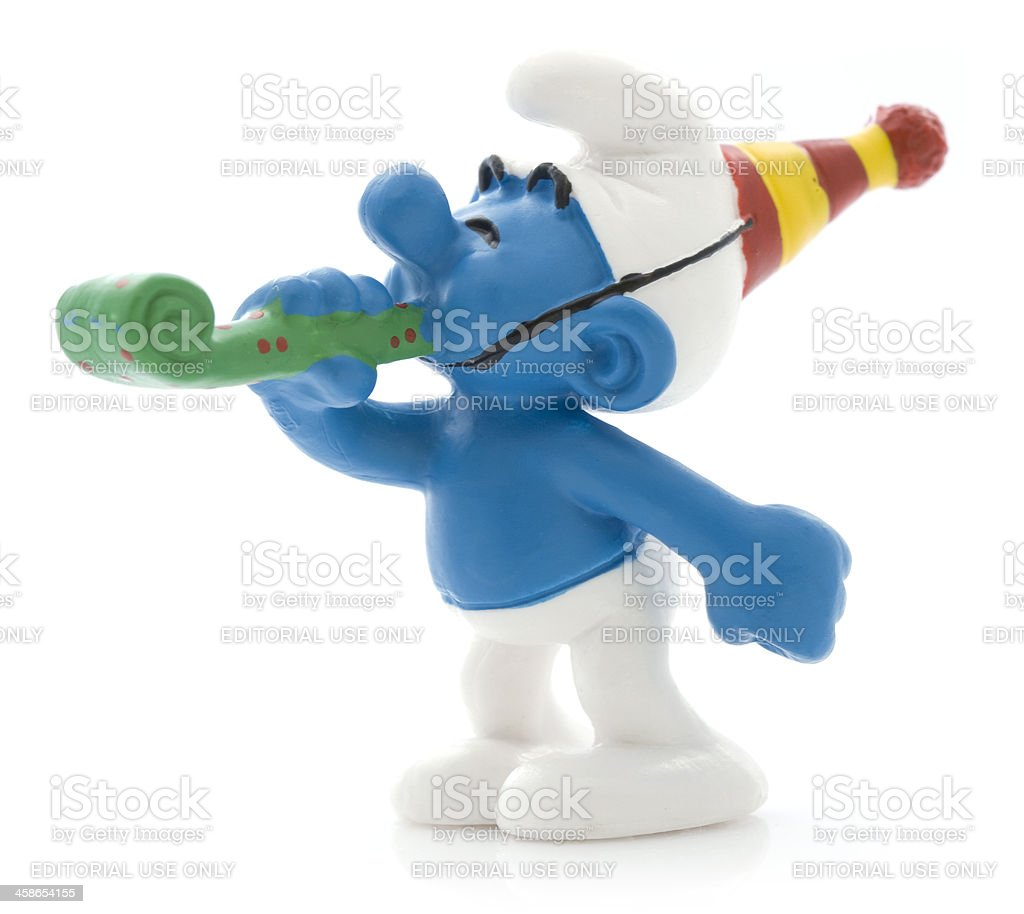 Smurf with party horn royalty-free stock photo