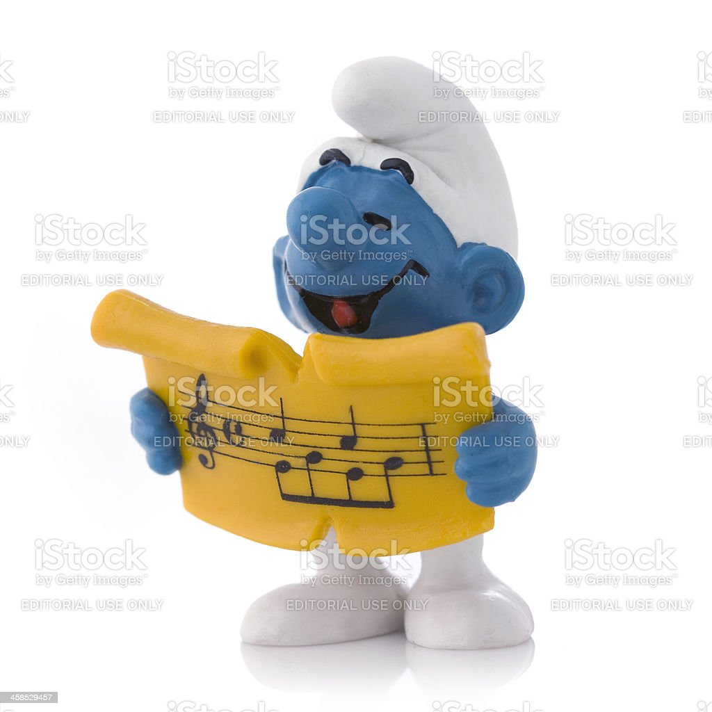 Smurf with song sheet stock photo