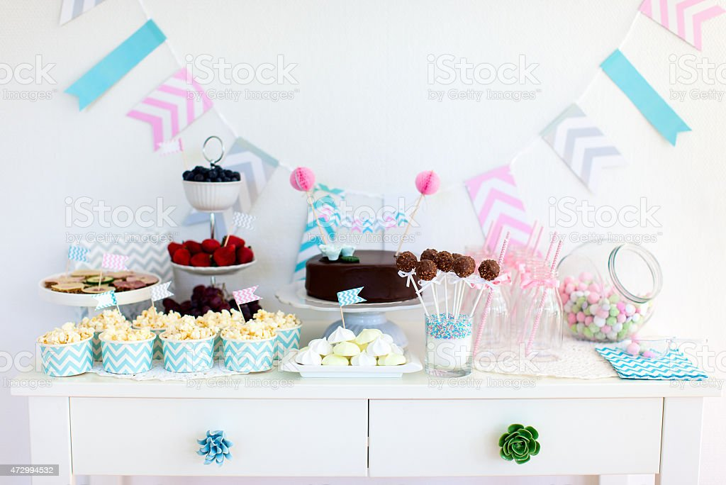 Snack and dessert table for a party​​​ foto