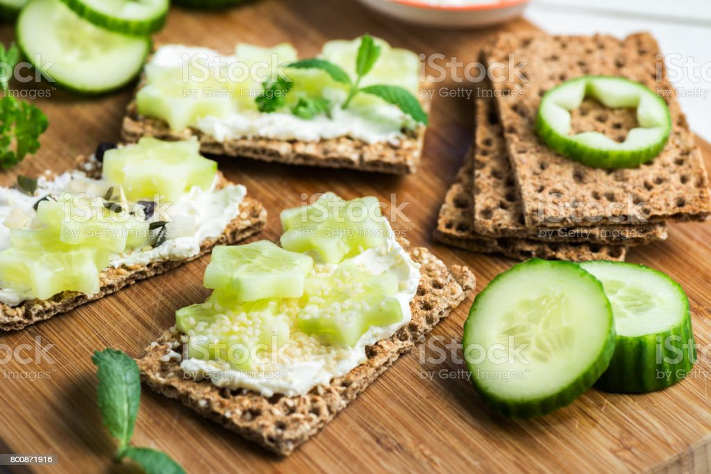 Snack from Wholegrain Rye Crispbread Crackers and Cucumber stock photo