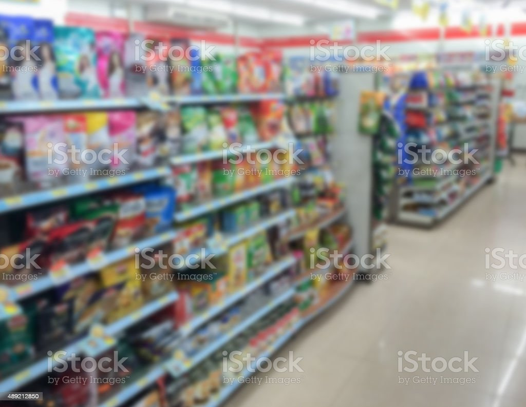 snack in shelf at supermarket on blur background stock photo