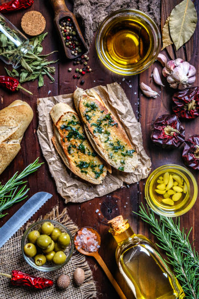 Snack or appetizer of garlic basil and olive oil bruschetta on table in a rustic kitchen stock photo