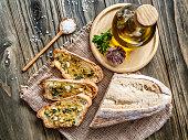 Snack or appetizer of garlic basil and olive oil bruschettas. Garlic bread.