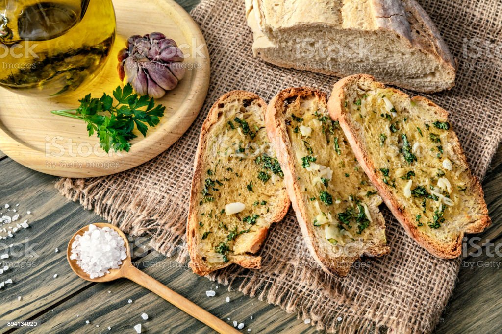Snack or appetizer of garlic basil and olive oil bruschettas stock photo