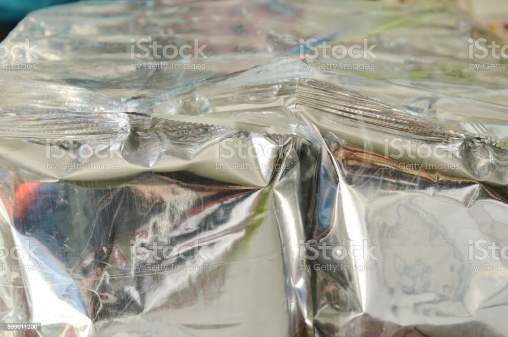 snack package in aluminum foil wrapped with clear plastic bag