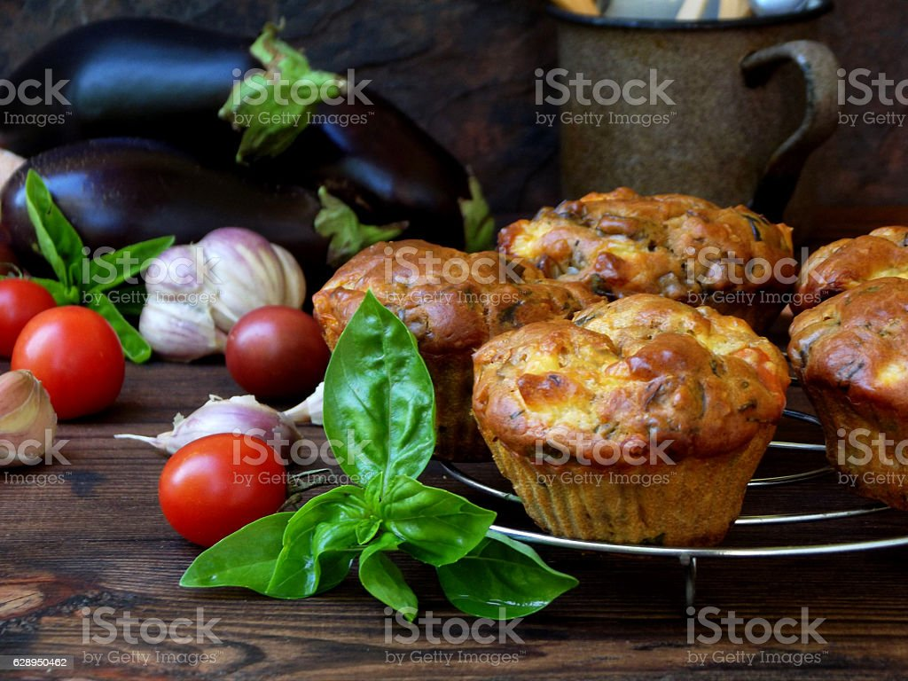 snack savory muffins cakes with eggplant, tomatoes, basil and cheese stock photo