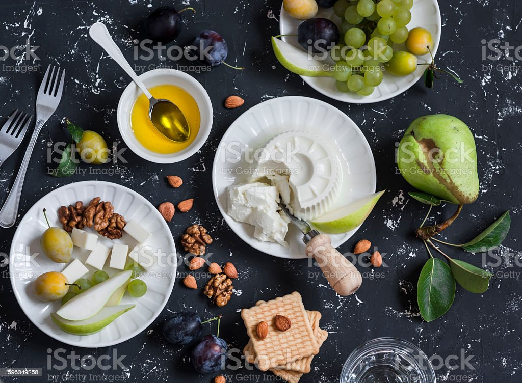 Snack table - cheese, grapes, pears, plums, nuts, honey, cracker royalty-free stock photo