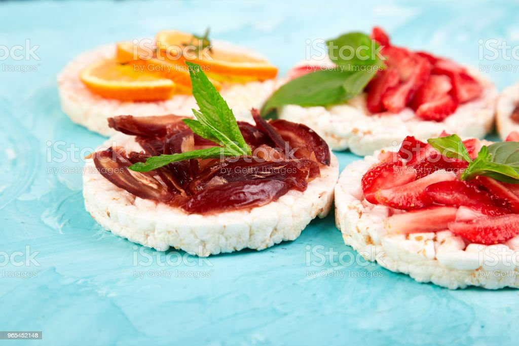 Snack with rice crispbread and fresh fruits royalty-free stock photo