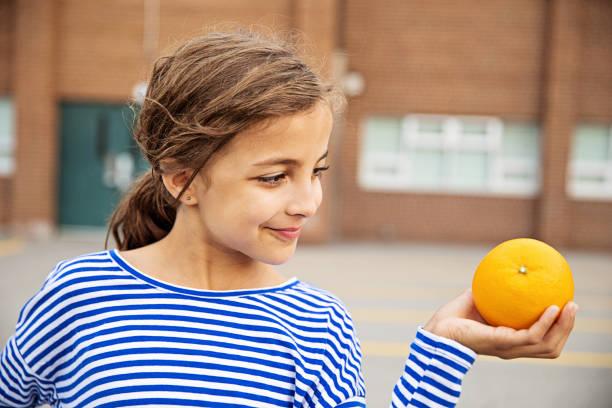 Snacking on Fresh Fruit stock photo