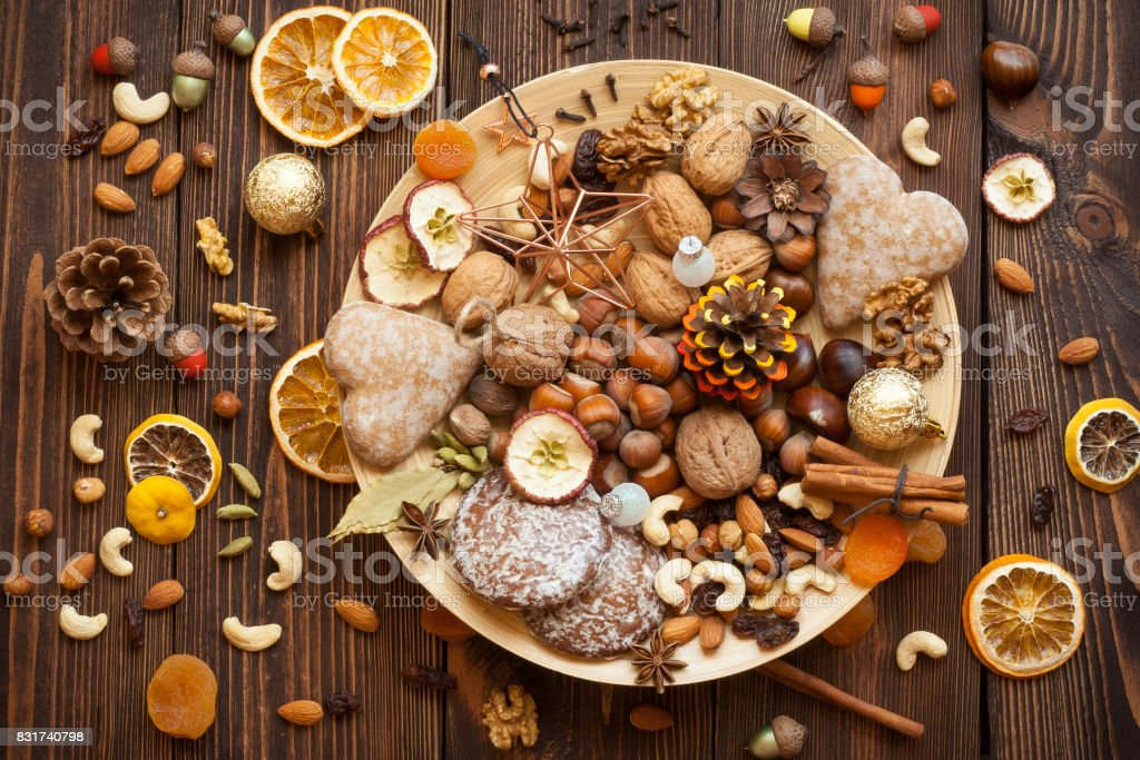 Snacks and decorations for Christmas on a bamboo plate. stock photo