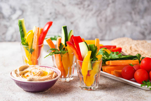 Snacks bar.  Vegetables sticks and hummus Snacks bar. Healthy vegetables sticks and hummus yellow bell pepper stock pictures, royalty-free photos & images