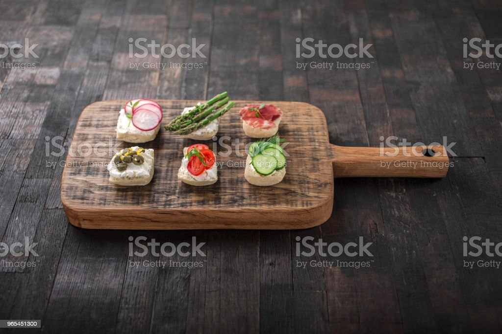 Snacks On A Wooden Board Stock Photo & More Pictures of Appetizer