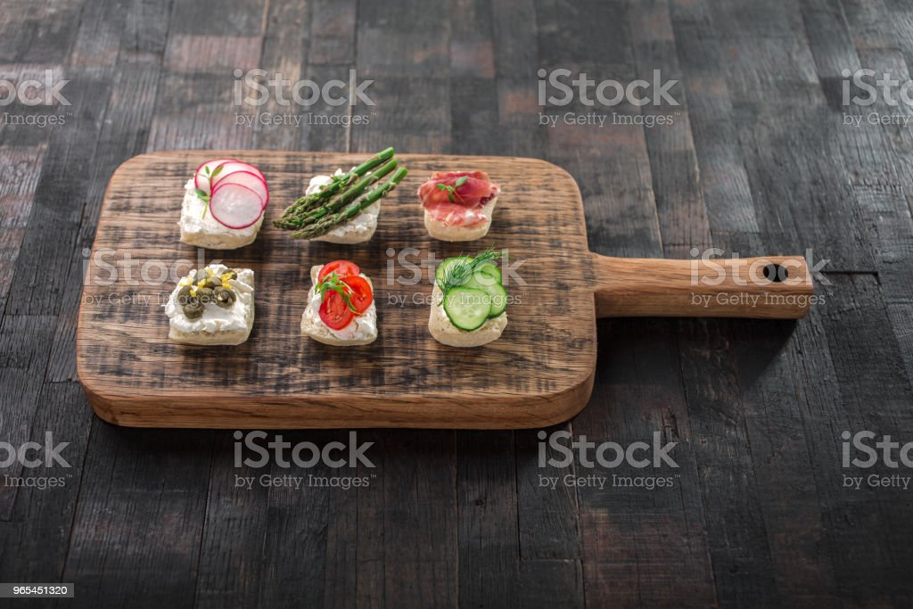 snacks on a wooden board royalty-free stock photo
