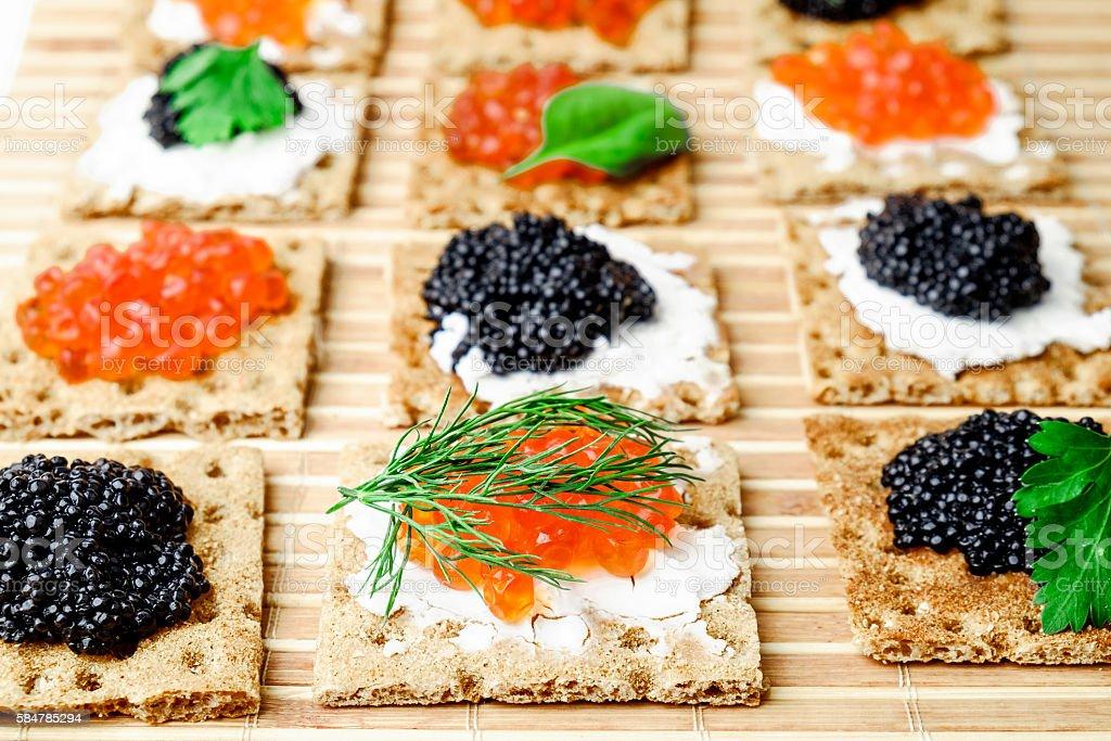 Snacks with caviar stock photo