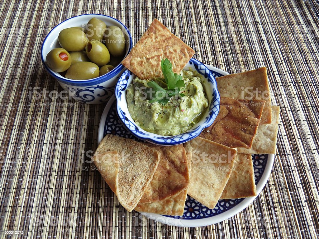 Snacks with olives and hummus stock photo