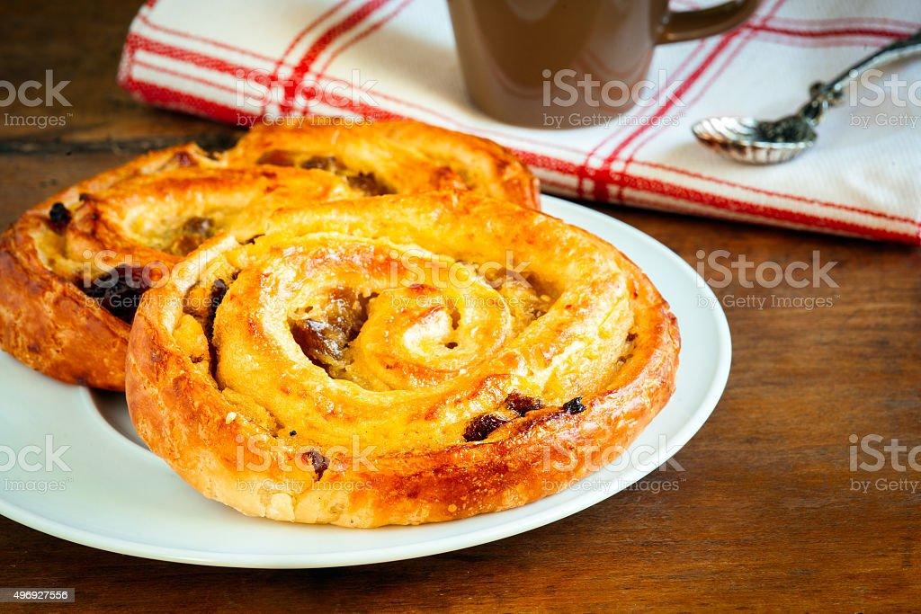 Snail pastry or pain au raisin stock photo