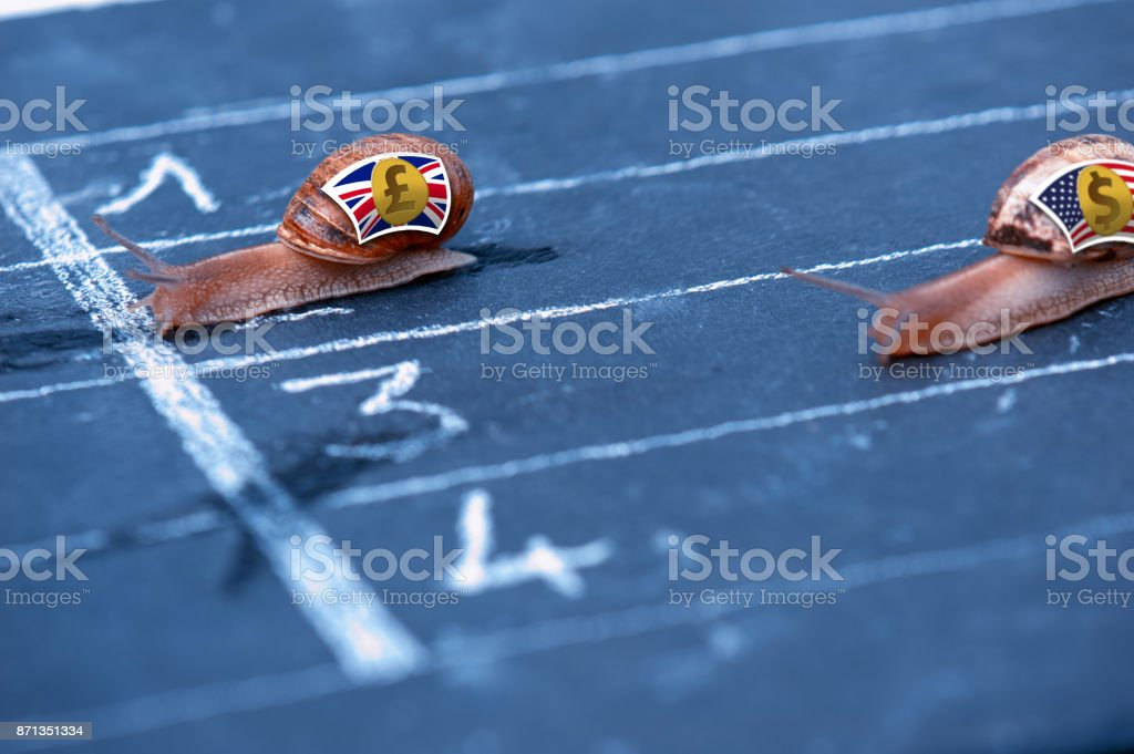 Snails race currency metaphor about Pound sterling against US Dollar stock photo