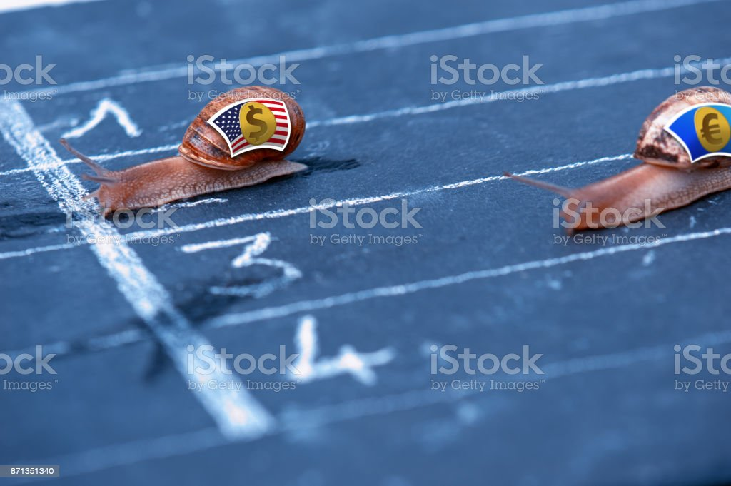 Snails race currency metaphor about US Dollar against Euro stock photo