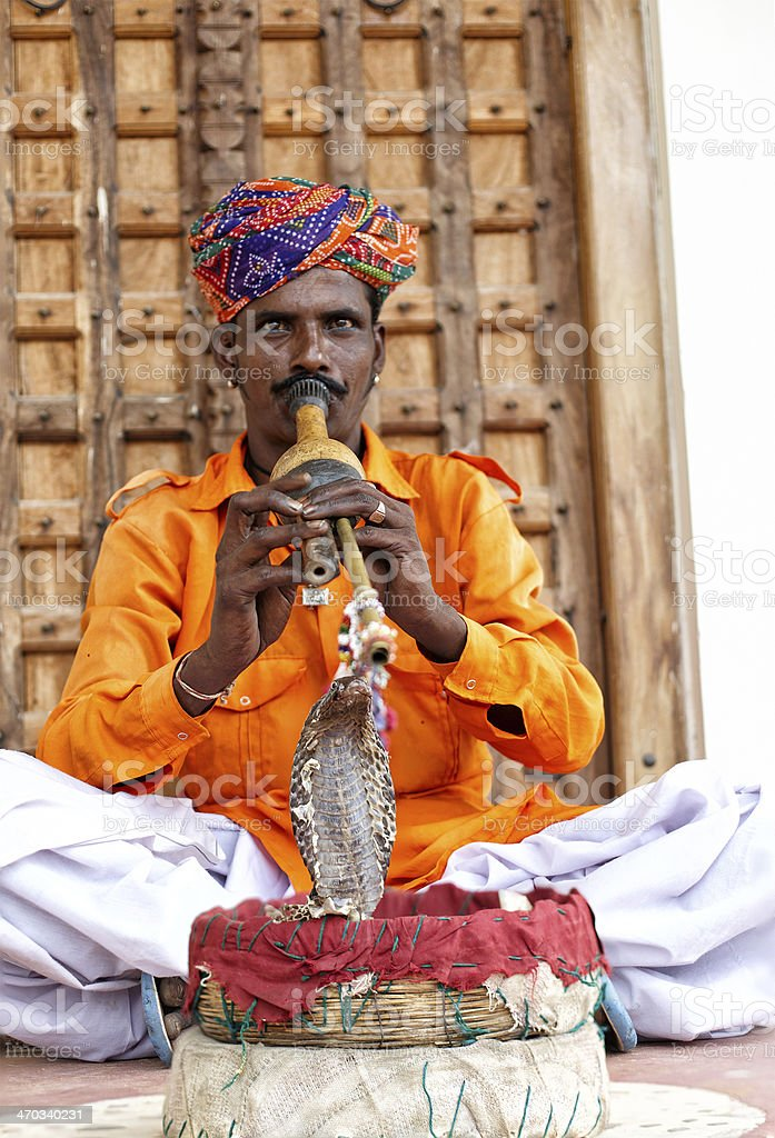 Snake charmer in action on Indian street stock photo