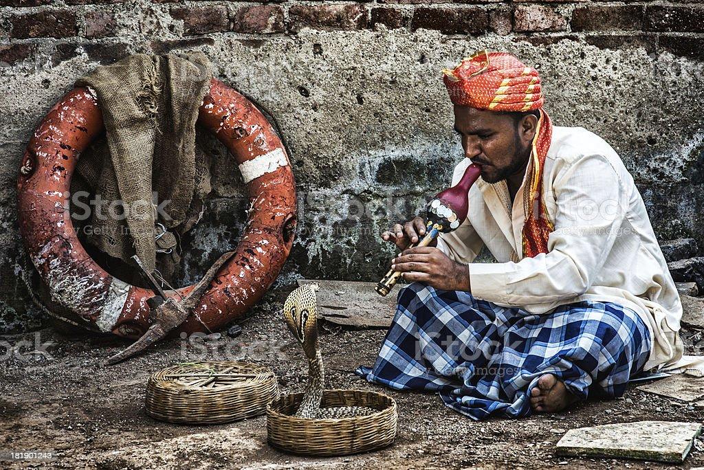 Snake charmer stock photo