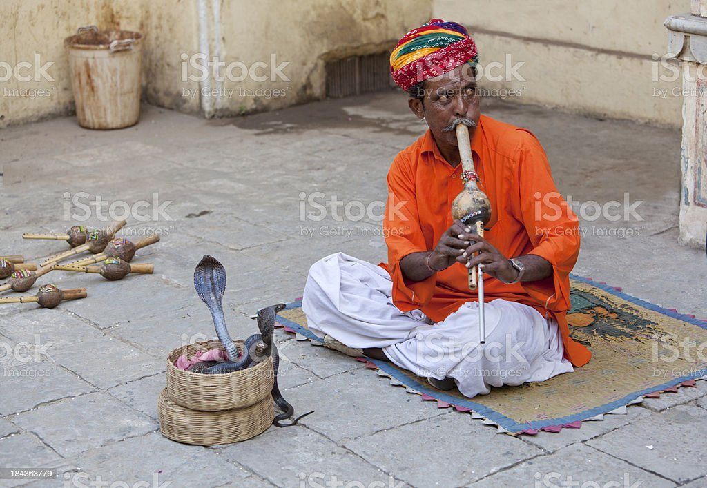 Snake charmer with flute and snakes stock photo