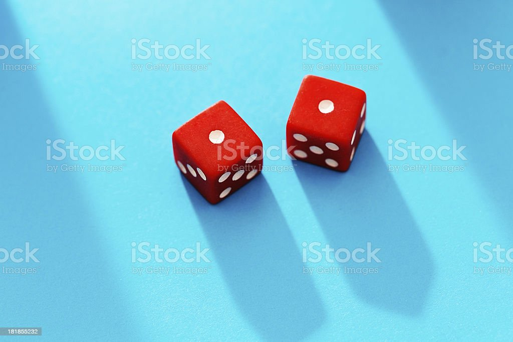 Snake eyes! Two red dice on a turquoise background royalty-free stock photo