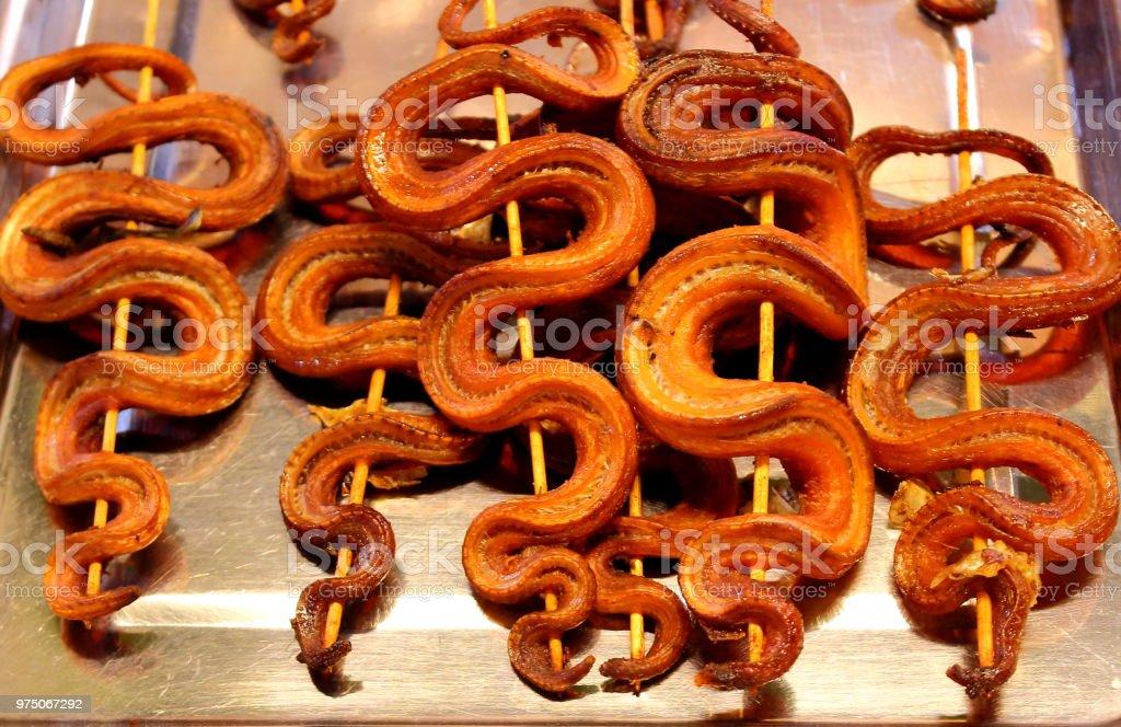 Snake kebab in Cambodian market stock photo