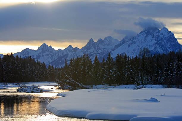 Snake River at sunset below Grand Teton Mountain Range stock photo