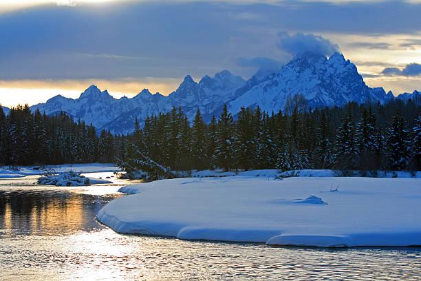 Snake River at sunset below Grand Teton Mountains stock photo