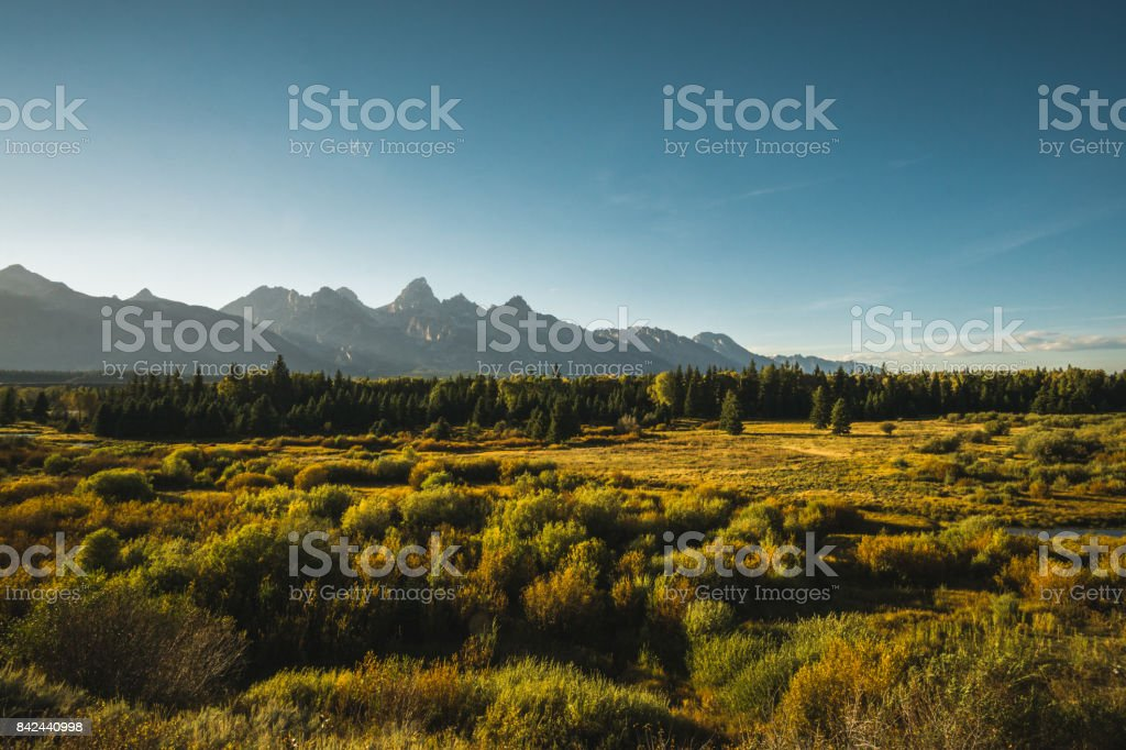 Snake River Valley and the Teton Range on a later autumn afternoon. stock photo