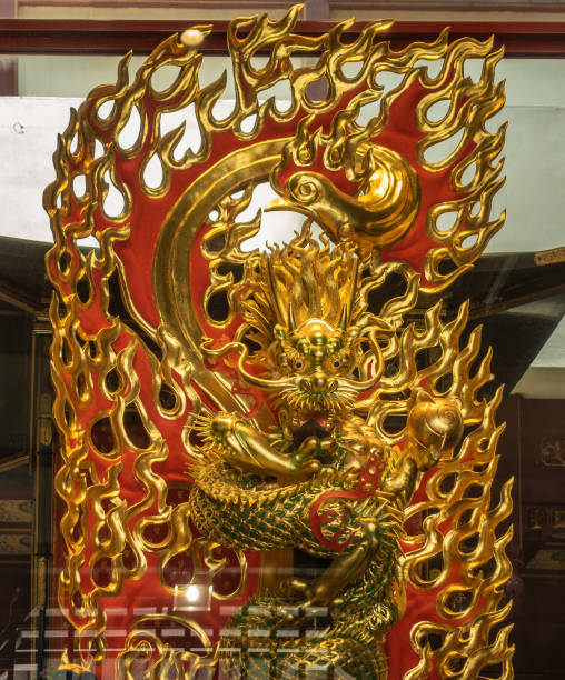 Snake Vajra in flames at Buddha Tooth Relic Temple, Singapore. stock photo