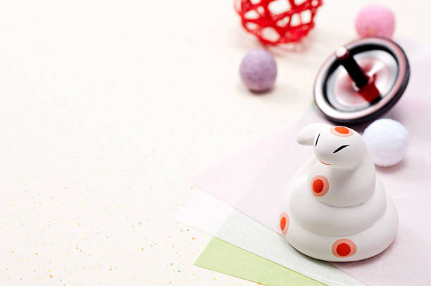 Snake zodiac figurine and New Year accessories - Photo