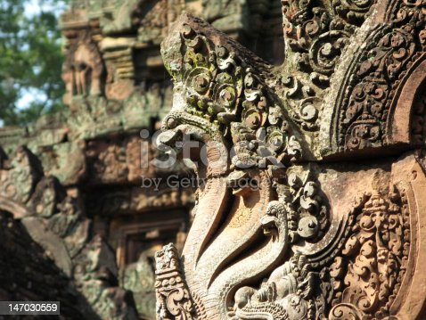 A multi-snakehead carving found on the temple in Banteay Srei, Siem Reap Cambodia.The temple is known as the citadel of women.