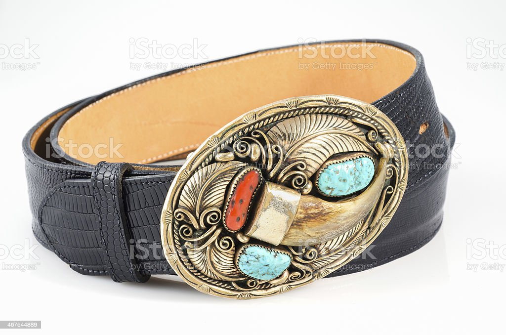Snakeskin Belt with Ornate Bear Claw Buckle. stock photo