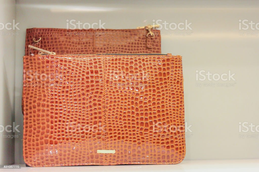 Snakeskin clutch bag on display store stock photo