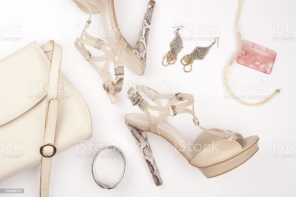 Snakeskin platform heels with earrings bracelet and bag stock photo