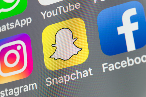 Snapchat, Facebook, Instagram and other cellphone Apps on iPhone screen