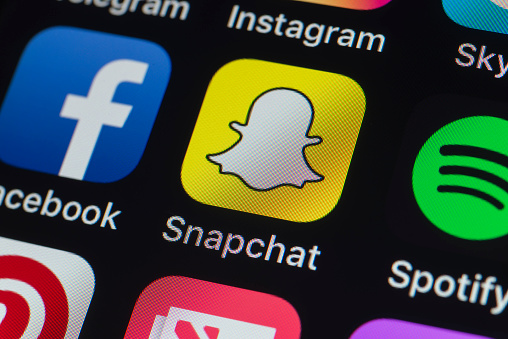 Snapchat, Facebook, Spotify and other phone Apps on iPhone screen