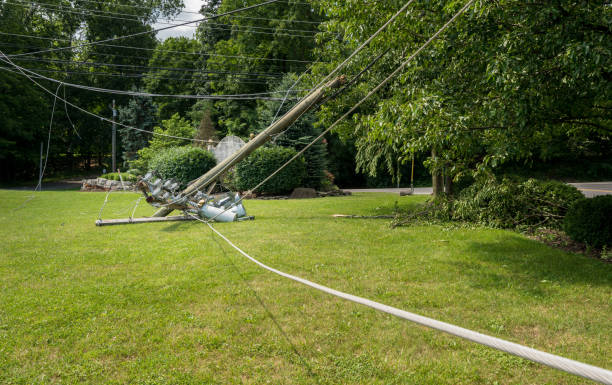 Snapped and downed power post and line after storm Broken snapped wooden power line post with electrical components on the ground after a storm knocked down stock pictures, royalty-free photos & images
