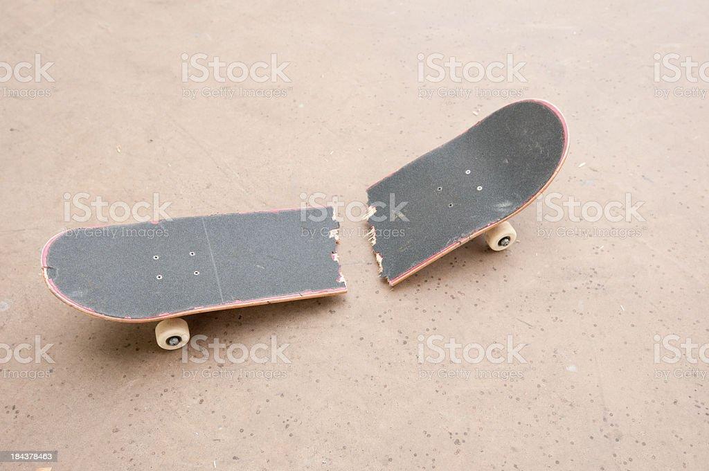 Snapped skateboard deck stock photo